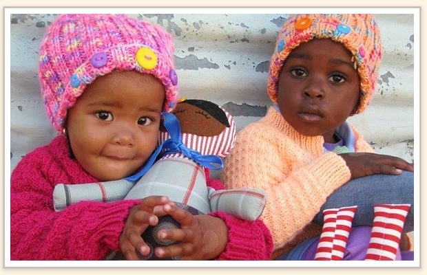 Knitting for charity for children is more than providing warmth